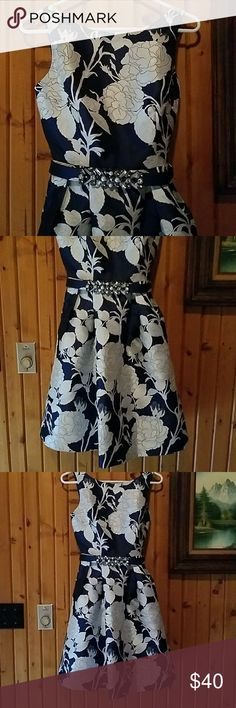 Eliza J a line dress Gorgeous deep navy A line dress with large silver flower details, bead and pearl belt, side slit pockets. One scratched area on front from belt. Worn once for a wedding, dry cleaned. Eliza J Dresses Midi