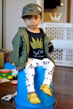 Follow @beckettoakes on Instagram for more boy fashion and #ootd inspiration. Camo hat by Carter's, Wild Thing tank by Little Rascals Shop, Army green jacket by Gap Kids, black and white triangle leggings by The Sprouted Arrow, yellow Moccs by Freshly Picked.
