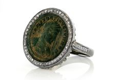 This ring from the Versilia collection features an ancient Roman coin set in oxidized sterling silver and surrounded by diamond pavé.