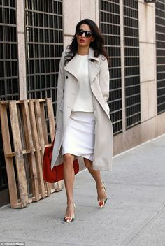 International human rights lawyer Amal Clooney looked summery in a cream outfit with orang...