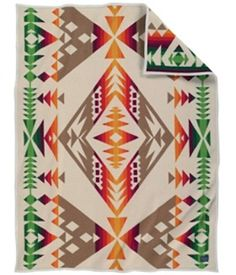 DIAMOND MEDALLION THROW This jacquard throw is just the right size for napping, reading or simply admiring. Toss it over a sofa or chair, or fold at the foot of the guest bed. The intricate and bright Native American-inspired design is sure to be a conversation starter wherever it lands. Pendleton Woolen Mills