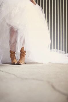 Here you go Terrie cowboy boots with your wedding dress...I love the look!