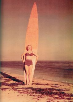Marilyn Monroe with surfboard, 1952