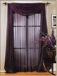 Purple draperies with golden cords and embroidered sheer curtains ...