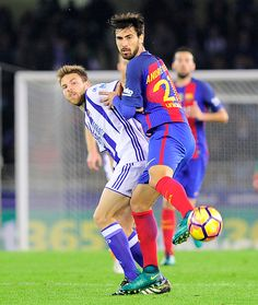 Real Sociedad's midfielder Asier Illarramendi vies with Barcelona's Portuguese midfielder Andre Gomes during the Spanish league football match Real...