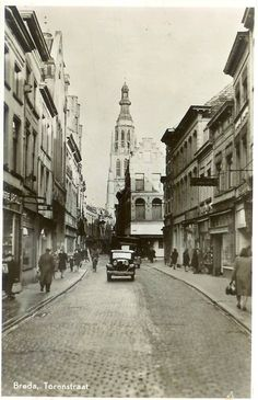 An old view of Torenstraat, Breda, located in the Soutern part of Holland. Vintage Pictures, Old Pictures, Dream Vacations, Netherlands, Holland, Dutch, Places To Visit, Street View, Black And White