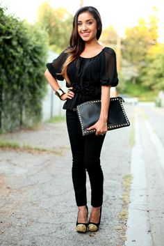 Classy in black. Wear a black blouse pair with black leggings or jeans. Add some dressy high heels and a studded clutch for an edgy yet dressy feel.