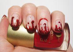 Halloween blood drip nails.