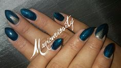 Metallic blue and silver stiletto gel nails