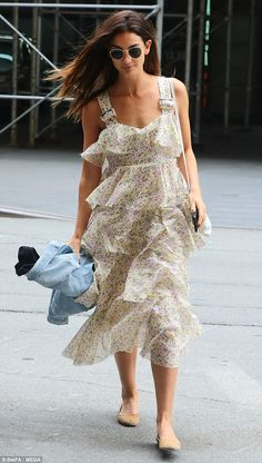 Light and airy: Lily Alridge, 31, enjoyed the warm weather in New York City while returning to her hotel in a flowing summery frock with a flower pattern