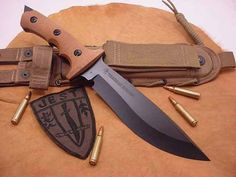 "One ""bad"" new custom Combat Fighting knife.."