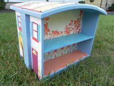 Bedside Table Turned DIY Dollhouse - Flipped on their sides, drawers doctored up with patterned paper morph into something out of a picture book.