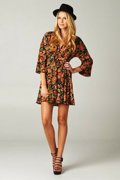 """This gorgeous flowy floral dress has an empire waist with tie in back for ease of fit.  With cute bell sleeves & a v-neck, this dress would be adorable with leggings & boots.  100% Polyester Hand Wash, Line Dry Made in the USA  Designer: Mono B  Measurement for a SMALL: Empire bust without it tied in back: 30"""" Length from Shoulder seam to hem: 33"""" $35.00"""
