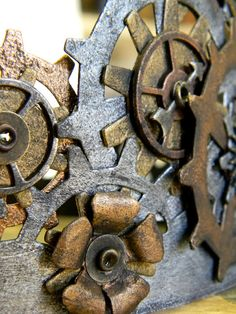 """Love these gears! Made from metal paints and charms. SO fun. """"created from chipboard, die cut, using various Tim Holtz/Sizzix dies, paint,  and a lot of different Idea-ology embellishments."""""""