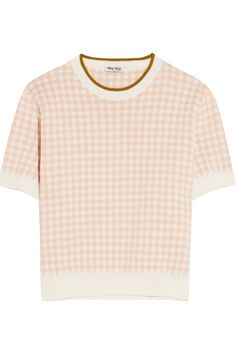 Miu Miu's blush and white cotton sweater is knitted with a gingham intarsia. This short-sleeved design has a contrast color and shortened torso that will work best with high-rise pants or skirts. Style yours for day with pumps, or try layering it with a slip dress.
