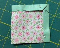 Fold again to form a mitered corner