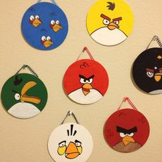 Angry bird art! $.79 plywood circle from craft store, acrylic paint, and a strip of ribbon hot glued to the back!