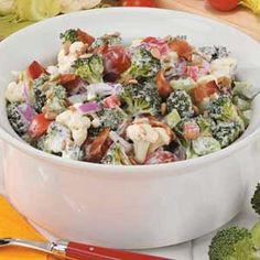 Quick Calico Salad Recipe -This is a light, colorful and tasty salad. Fortunately, it travels well because it's an expected dish at my family reunions.—Joanne Neuendorf, Potosi, Wisconsin