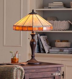 Add distinctive lighting to your décor with our Tiffany-Style Stained Glass Mission Style Table Lamp. The timeless amber-hued Mission design is highlighted by the Tiffany-inspired, hand-applied 72 pieces of glass with copper foiling. A beautiful, functional accent for any room!