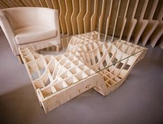 This coffee table makes my nerdy heart glad. It looks like a calculus 3 graph with a piece of glass on top.