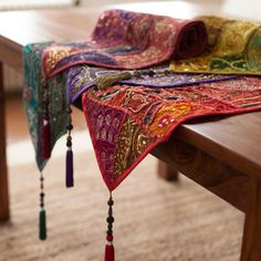 These Moti Ari Table Runners are made from recycled wedding saris. Decorated with beguiling beads and dewy-eyed sequins. Available in 5 colours.
