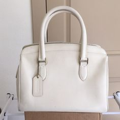 COACH Vintage Madison Sutton 4410 Made in Italy Vintage white leather Coach Madison Sutton 4410. Very rare! Handcrafted in Italy - finely textured full-grown cowhide.   Original coach tag.  Inside lined w/ taupe color fabric and one pocket serial #L5E-4410.  Brass zipper close and 2 handles  (does NOT come w/ original leather strap - lost).  10.5in x 8.5in x 5.5in   Pre-loved - favorite for years. Small marks outside, signs of wear around edges on bottom (1 small rip in fabric, dark stains…