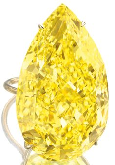 Princess Jasmine engagement ring. The Sun Drop diamond, a legendary 110.03 carat fancy vivid yellow pear-shaped diamond, shown here mounted on a gold ring setting. Via Diamonds in the Library.