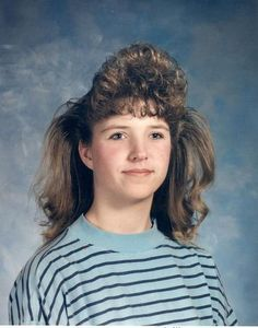 Cloud of Bangs  Shelley V. from Scappoose, Oregon sent in this photo of herself, and we thought it was hilarious. We've seen a lot of bangs with volume, but this is certainly our first case of teased sideburns.