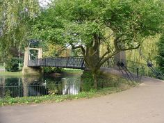 Wardown Park, Luton, England. The bridge over the lake in Wardown Park, you used to be able to use paddle boats and rowing boats on the lake many,many years ago.
