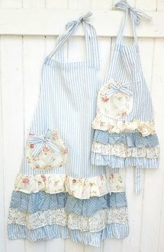 Very pretty Mommy and Me set of aprons in blue stripe with pretty floral ruffles. Mommy and me apron set. - Very pretty Mommy and Me set of aprons in blue stripe with pretty floral ruffles. Mommy and me apro - Ruffle Apron, Apron Dress, Cute Aprons, Sewing Aprons, Apron Designs, Aprons Vintage, Creation Couture, Mommy And Me, Diy Clothes