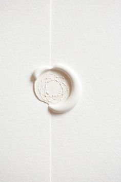 white wax seal on white stationery. must have used a wax gun to keep the white so pure & free of the carbon debris from candle burning.
