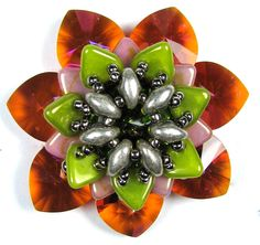 Series of schema & thread paths for this 2-holed bead flower. ~ Seed Bead Tutorials
