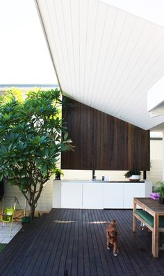 """Mix up the decking with some artificial turf and see your balcony take on a """"designer"""" look and feel."""