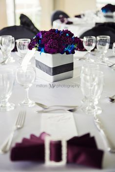 Purple, blue, black and white wedding decor,  I like this for table decor, simple and classy.