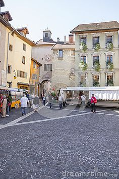 Market in small  town Annecy,France. Old street and people on street market .  http://en.wikipedia.org/wiki/Annecy