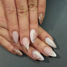 Nude and glitter nail art.