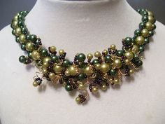 This piece is inspired from my love of vintage collars with a bit more decoration in the center.    There are three rows of glass pearls.    The