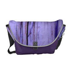 Old cracked purple paint on wood messenger bag