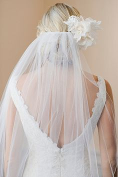 veil with floral hairpiece.