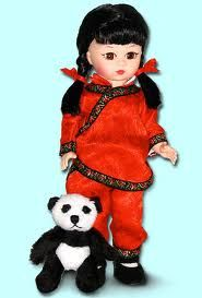 """Helping Hands for China $67.96 Helping Hands For China was designed to help bring attention to the plight of China's """"gentle giant Pandas"""". This 8-inch Asian-sculpt doll has black hair braided in pigtails tied with red ribbon. She wears a traditional red brocade silk, side-fastened Tangzhuang-style suit with a mandarin collar trimmed with embroidered ribbon.......(visit www.duchessoutlet.com for full product description)."""