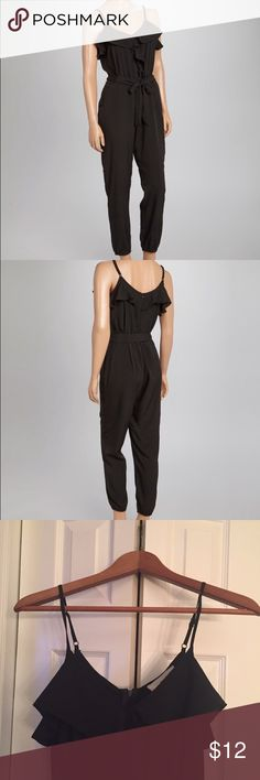 Sans Souci Black Spaghetti Strap Jumpsuit This stylish jumpsuit sports flirty ruffles about the neck and sultry spaghetti straps that can be adjusted for a perfect fit. Adjustable straps 100% polyester. Hand wash; hang dry.  Belt not included. Sans Souci Other