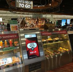 Embedded digital signage, integrated in restaurant furniture. In Hong Kong Airport. #digitalsignage #mainosnaytto