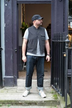 David R from our London stores wearing our field cap, battle waistcoat, pocket tee, regular fit jeans and Saucony shadow og trainer