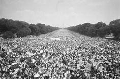 """ORIGINAL CAPTION: This photo, made from the Lincoln Memorial, shows the huge crowd, estimated at close to 59,000, that attended the Poor People's """"Solidarity Day"""" rally. Note many of the marchers wading in the reflecting pool beneath the Washington Monument, June 19, 1968 — in Washington, District of Columbia.  Photo credit: Getty"""