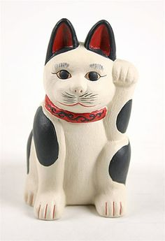 This Maneki Neko has a nice folk art feel.