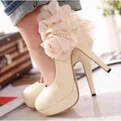 Cream heels with flower embellishment by the heel