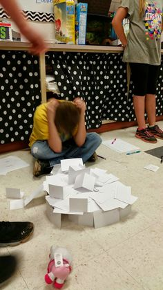 Engineering challenge: one pack of index cards and 12 inches of tape. Build a structure at least 2 ft tall that can hold a small stuffed animal.