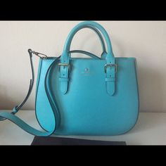 Kate Spade iconic turquoise handbag- EUC Gorgeous vibrant turquoise saffiano leather bag with strap that converts to cross body, polka dot lining, 2 interior pockets, 1 zip pocket. * bag is in excellent condition, there are a few pen marks inside the bag - see pics Dust Bag included kate spade Bags Satchels