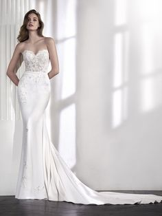 """""""LAIA"""" l Sensual and very sexy. A mermaid wedding dress with a crepe skirt and lace bodice, it has embroidered tulle and beaded Chantilly appliqués."""