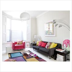 I'm in love with this living room - the sofa, the chair, the cushions - actually the whole apartment.  [GAP Interiors - Modern living room - Picture library specialising in Interiors, Lifestyle & Homes]